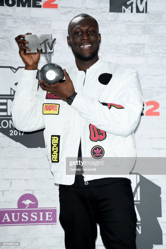Rapper Stormzy poses with the award for the UK and Ireland Worldwide Act in the Winners Room during the MTV EMAs 2017 held at The SSE Arena, Wembley on November 12, 2017 in London, England.