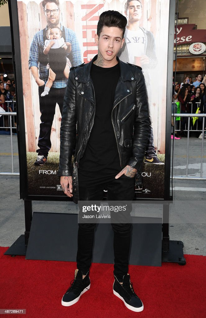 Rapper <a gi-track='captionPersonalityLinkClicked' href=/galleries/search?phrase=T.+Mills&family=editorial&specificpeople=8062465 ng-click='$event.stopPropagation()'>T. Mills</a> attends the premiere of 'Neighbors' at Regency Village Theatre on April 28, 2014 in Westwood, California.