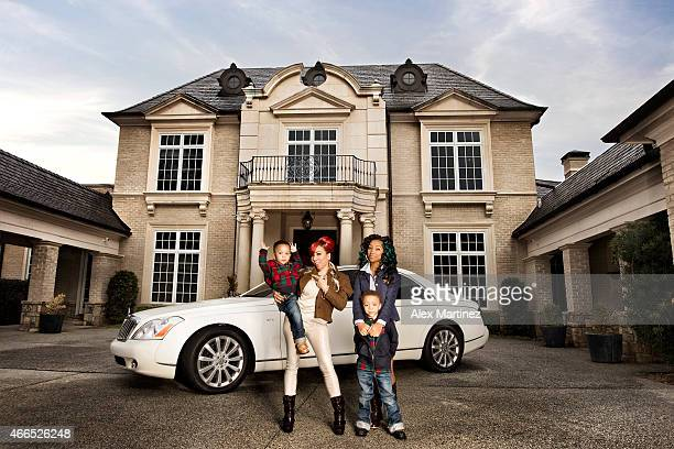Rapper Tameka Harris is photographed with family for Vibe Magazine on December 21 2010 in Atlanta Georgia