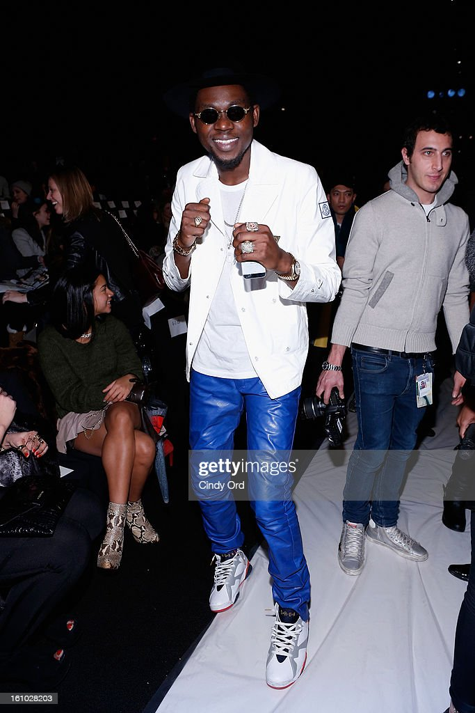 Rapper <a gi-track='captionPersonalityLinkClicked' href=/galleries/search?phrase=Theophilus+London&family=editorial&specificpeople=5770992 ng-click='$event.stopPropagation()'>Theophilus London</a> attends the Rebecca Minkoff Fall 2013 fashion show during Mercedes-Benz Fashion at The Theatre at Lincoln Center on February 8, 2013 in New York City.