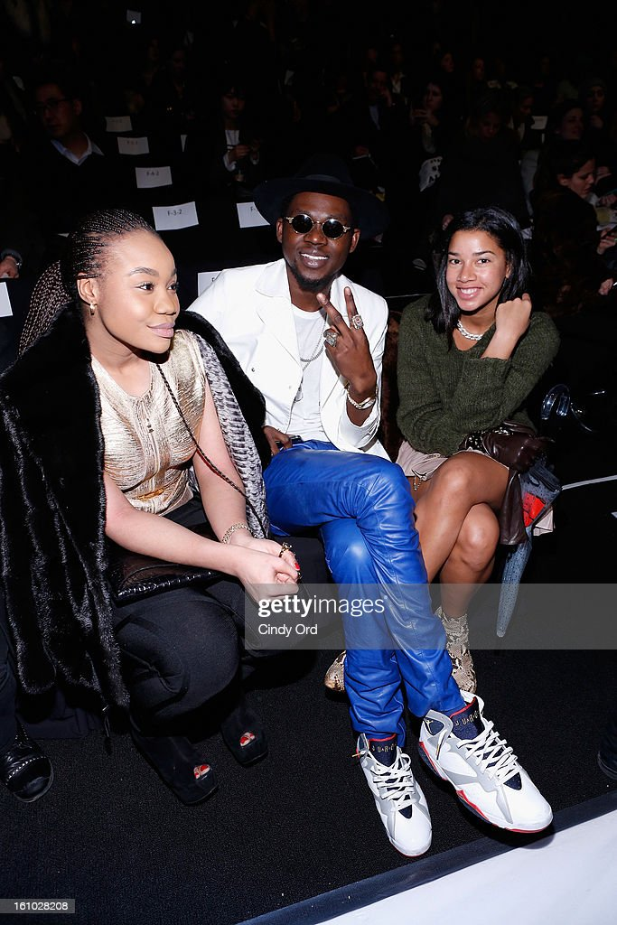 Rapper <a gi-track='captionPersonalityLinkClicked' href=/galleries/search?phrase=Theophilus+London&family=editorial&specificpeople=5770992 ng-click='$event.stopPropagation()'>Theophilus London</a> (C) attends the Rebecca Minkoff Fall 2013 fashion show during Mercedes-Benz Fashion at The Theatre at Lincoln Center on February 8, 2013 in New York City.