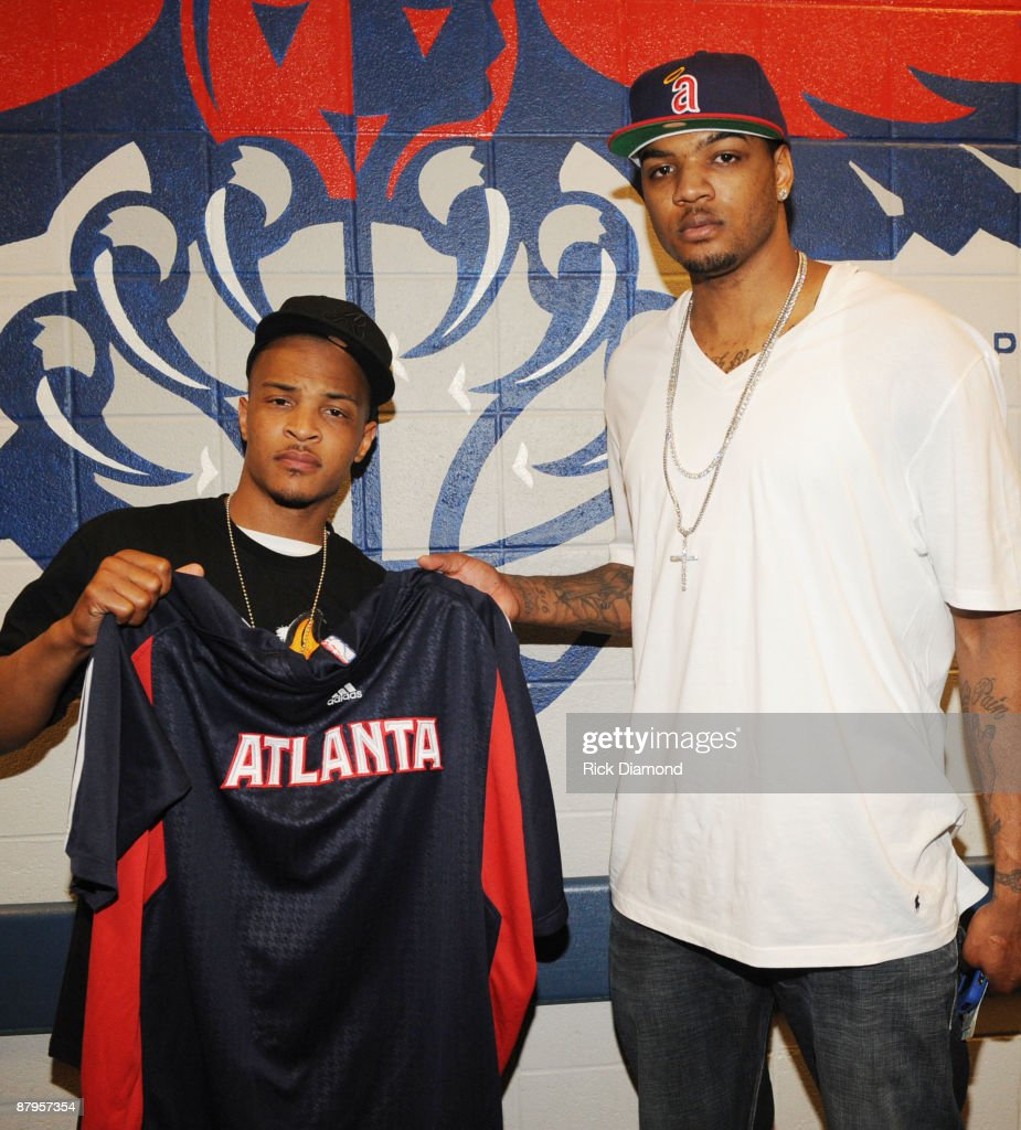 Rapper T.I. and Atlanta Hawk, Josh Smith backstage at the Philips Arena on May 24, 2009 in Atlanta, Georgia.
