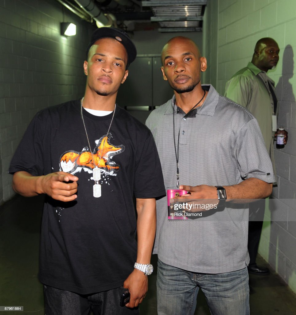 Rapper T.I. (L) and Kenan Woods of Philips Arena/Atlanta Spirit pose backstage at T.I.'s Final Countdown Concert at Philips Arena on May 24, 2009 in Atlanta, Georgia.