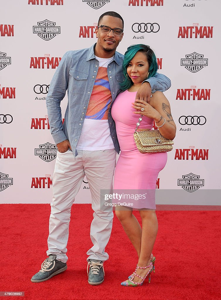 Rapper <a gi-track='captionPersonalityLinkClicked' href=/galleries/search?phrase=T.I.&family=editorial&specificpeople=221599 ng-click='$event.stopPropagation()'>T.I.</a> and Tameka 'Tiny' Cottle-Harris arrive at the premiere of Marvel Studios 'Ant-Man' at Dolby Theatre on June 29, 2015 in Hollywood, California.