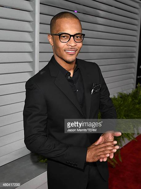 Rapper TI attends Maxim's Hot 100 Women of 2014 celebration and sneak peek of the future of Maxim at Pacific Design Center on June 10 2014 in West...