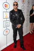 Rapper TI Harris arrives at the 2014 HYUNDAI / GRAMMYs Clive Davis PreGRAMMY Gala Activation Equus Fleet Arrivals at The Beverly Hilton Hotel on...