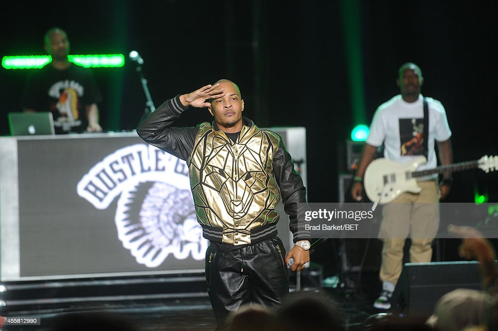 Rapper TI performs onstage during the BET Hip Hop Awards 2014 at Boisfeuillet Jones Atlanta Civic Center on September 20 2014 in Atlanta Georgia