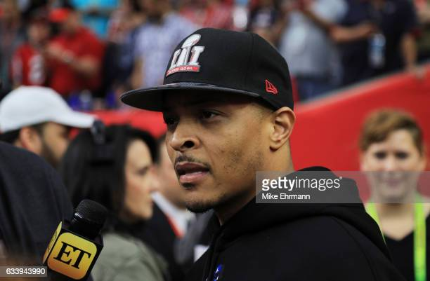 Rapper TI stands on the field prior to Super Bowl 51 between the New England Patriots and the Atlanta Falcons at NRG Stadium on February 5 2017 in...