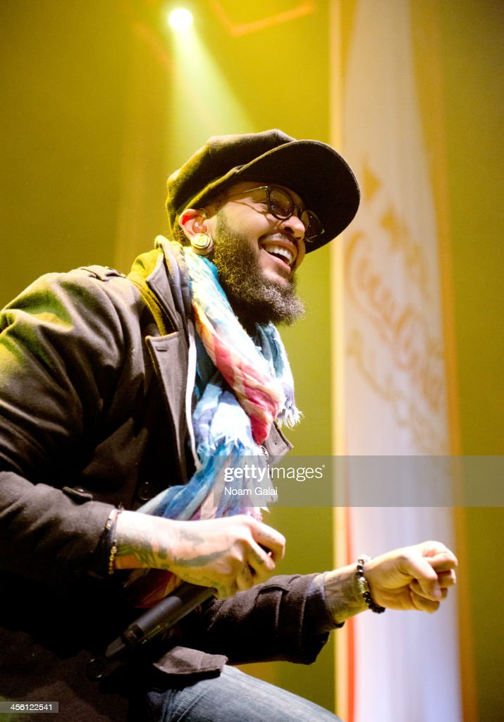 Rapper Travie McCoy performs at the Z100 & Coca-Cola All Access Lounge at Z100?s Jingle Ball 2013 pre-show at Hammerstein Ballroom on December 13, 2013 in New York City.