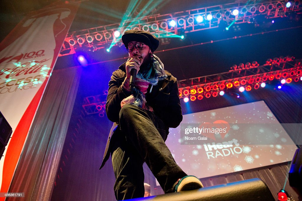 Rapper <a gi-track='captionPersonalityLinkClicked' href=/galleries/search?phrase=Travie+McCoy&family=editorial&specificpeople=4979725 ng-click='$event.stopPropagation()'>Travie McCoy</a> performs at the Z100 & Coca-Cola All Access Lounge at Z100?s Jingle Ball 2013 pre-show at Hammerstein Ballroom on December 13, 2013 in New York City.