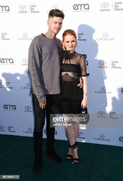 Rapper Travis Mills and Madelaine Petsch arrive at the 27th Annual EMA Awards at Barker Hangar on September 23 2017 in Santa Monica California