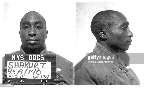 Rapper Tupac Shakur poses for a mug shot for the New York State Department of Corrections after his conviction for the sexual abuse of a female fan...