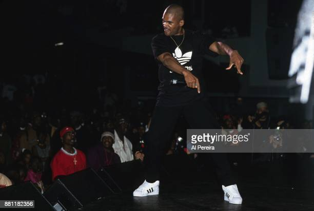 Rapper Tupac Shakur watches as DMC performs onstage at the Madison Square Garden's Paramount Theater during the first Source Awards on April 25 1994...
