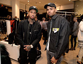 Rapper Tyga and recording artist Chris Brown attend the Balmain x HM Los Angeles VIP PreLaunch on November 4 2015 in West Hollywood California