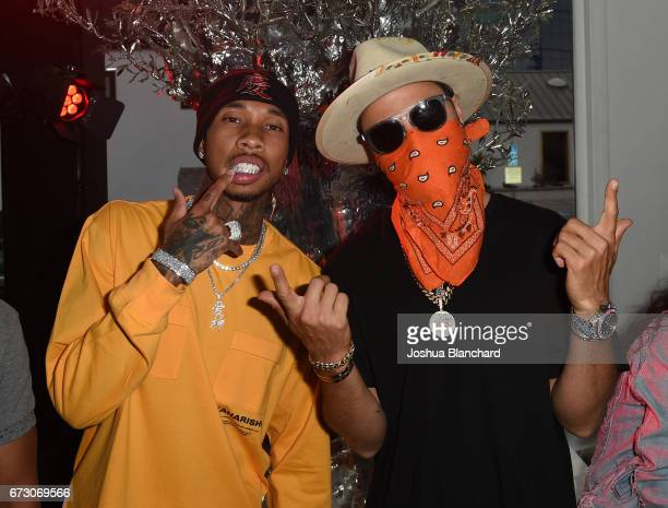 Rapper Tyga and TAG Heuer Art Provacateur Alec Monopoly attend TAG Heuer unveiling of Amgen Tour of California Best Young Rider Jersey with Brand...