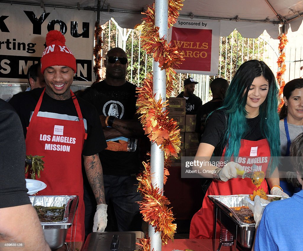 Rapper Tyga and TV personality Kylie Jenner attend the Los Angeles Mission And Anne Douglas Center's Thanksgiving Meal For The Homeless held at Los...