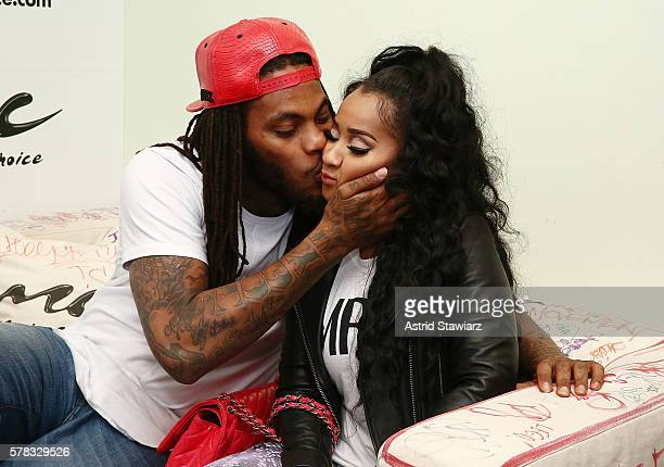Rapper Waka Flocka and TV personality Tammy Rivera share a kiss at Music Choice on July 21 2016 in New York City
