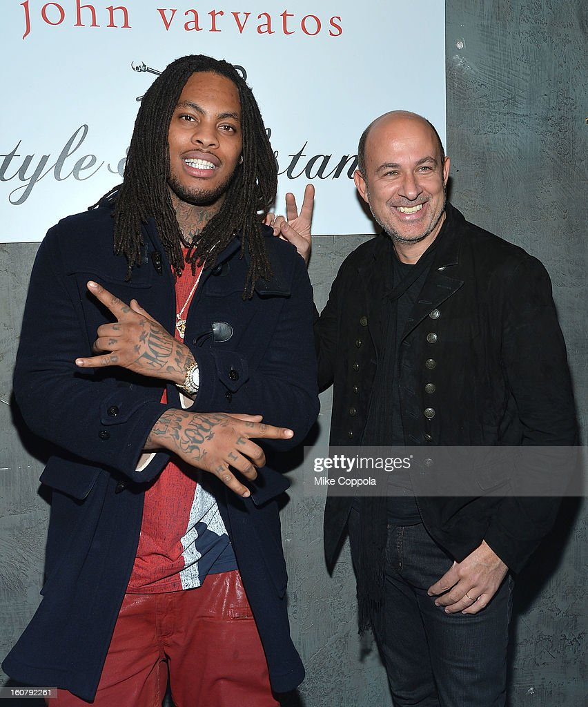 Rapper <a gi-track='captionPersonalityLinkClicked' href=/galleries/search?phrase=Waka+Flocka+Flame&family=editorial&specificpeople=6915851 ng-click='$event.stopPropagation()'>Waka Flocka Flame</a> (L) and fashion designer John Varvatos pose for a picture as they Celebrate The New JohnVarvatos.com on February 5, 2013 in New York City.