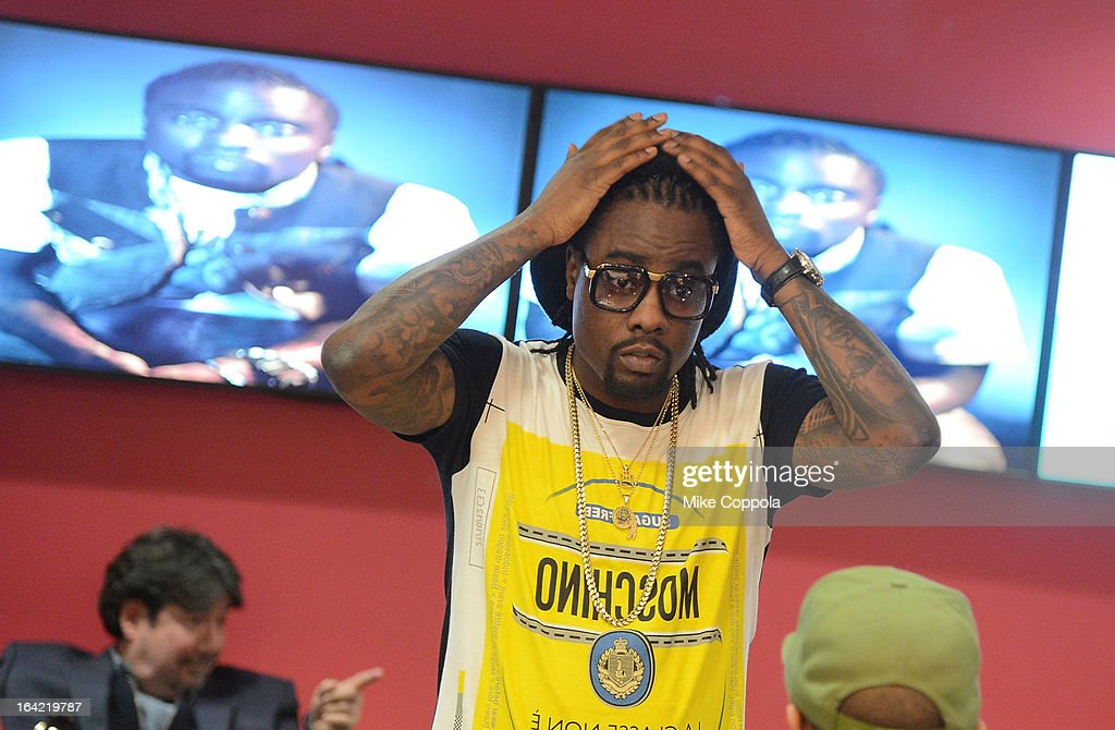 Rapper <a gi-track='captionPersonalityLinkClicked' href=/galleries/search?phrase=Wale+-+Rapper&family=editorial&specificpeople=8770277 ng-click='$event.stopPropagation()'>Wale</a> gets ready before his interview on BET's 106th & Park at 106 & Park Studio on March 20, 2013 in New York City.