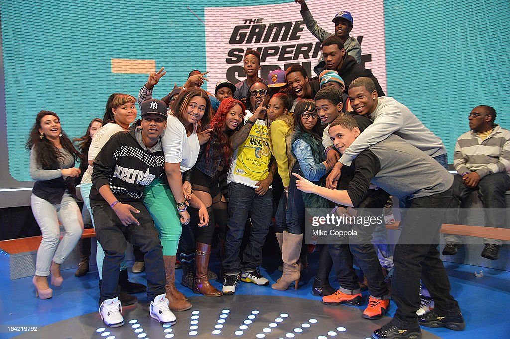 Rapper <a gi-track='captionPersonalityLinkClicked' href=/galleries/search?phrase=Wale+-+Rappeur&family=editorial&specificpeople=8770277 ng-click='$event.stopPropagation()'>Wale</a> greets fans after his interview on BET's 106th & Park at 106 & Park Studio on March 20, 2013 in New York City.