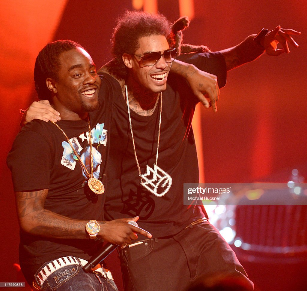 Rapper <a gi-track='captionPersonalityLinkClicked' href=/galleries/search?phrase=Wale+-+Rapper&family=editorial&specificpeople=8770277 ng-click='$event.stopPropagation()'>Wale</a> (L) performs onstage during the 2012 BET Awards at The Shrine Auditorium on July 1, 2012 in Los Angeles, California.
