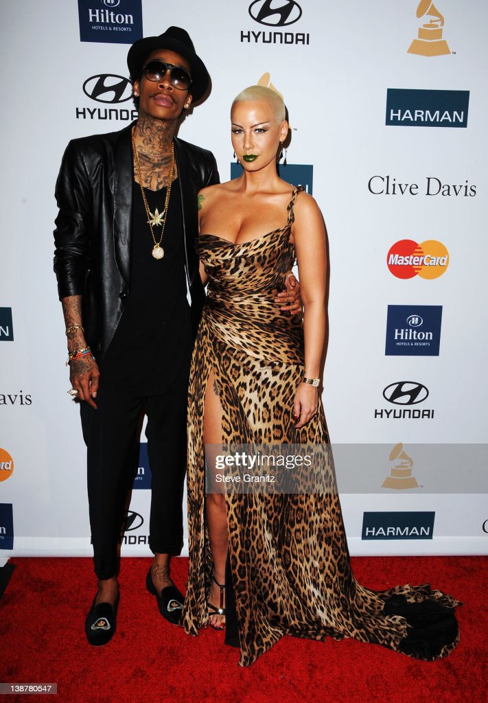 Rapper <a gi-track='captionPersonalityLinkClicked' href=/galleries/search?phrase=Wiz+Khalifa&family=editorial&specificpeople=7183449 ng-click='$event.stopPropagation()'>Wiz Khalifa</a> and <a gi-track='captionPersonalityLinkClicked' href=/galleries/search?phrase=Amber+Rose+-+Model&family=editorial&specificpeople=2025513 ng-click='$event.stopPropagation()'>Amber Rose</a> arrive at Clive Davis and The Recording Academy's 2012 Pre-GRAMMY Gala and Salute to Industry Icons Honoring Richard Branson at The Beverly Hilton hotel on February 11, 2012 in Beverly Hills, California.