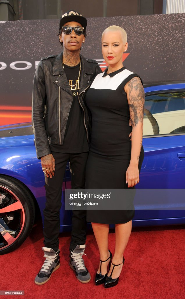 Rapper <a gi-track='captionPersonalityLinkClicked' href=/galleries/search?phrase=Wiz+Khalifa&family=editorial&specificpeople=7183449 ng-click='$event.stopPropagation()'>Wiz Khalifa</a> and <a gi-track='captionPersonalityLinkClicked' href=/galleries/search?phrase=Amber+Rose+-+Modell&family=editorial&specificpeople=2025513 ng-click='$event.stopPropagation()'>Amber Rose</a> arrive at the Los Angeles premiere of 'Fast & The Furious 6' at Gibson Amphitheatre on May 21, 2013 in Universal City, California.