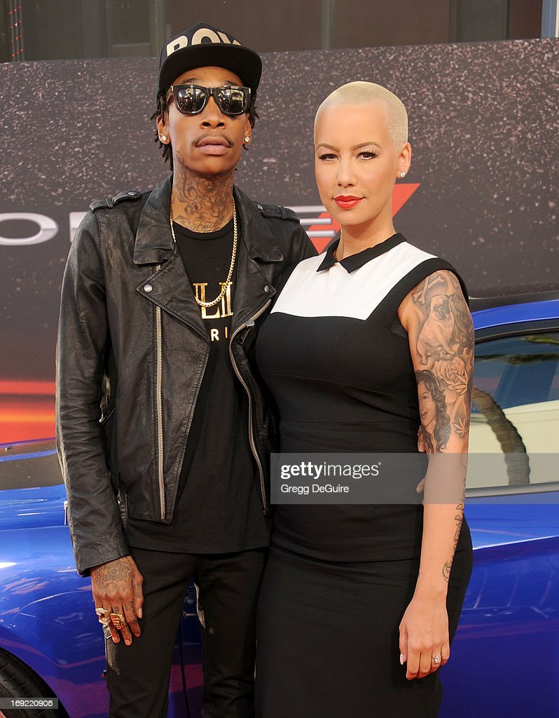 Rapper Wiz Khalifa and Amber Rose arrive at the Los Angeles premiere of 'Fast & The Furious 6' at Gibson Amphitheatre on May 21, 2013 in Universal City, California.