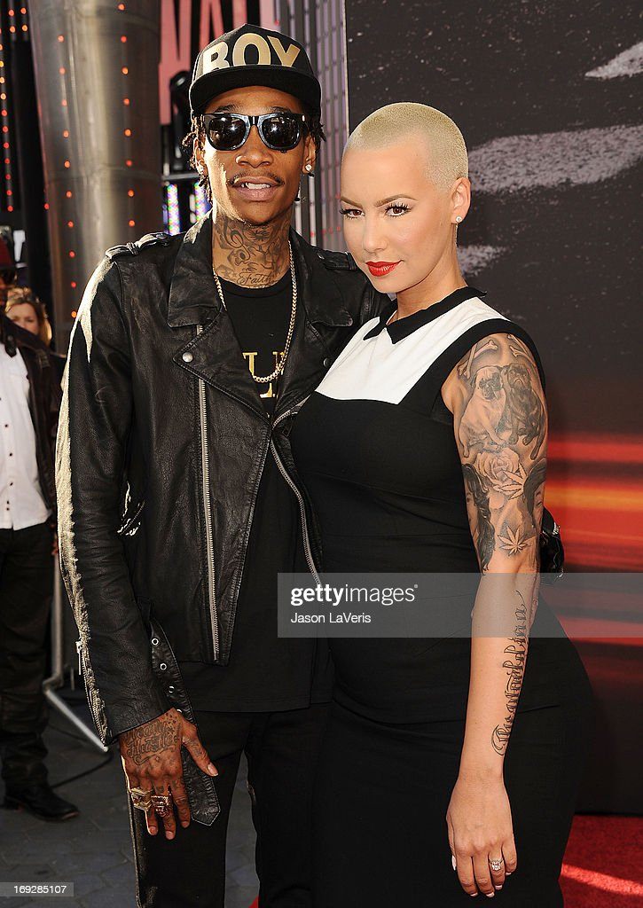 Rapper Wiz Khalifa and Amber Rose attend the premiere of 'Fast & Furious 6' at Universal CityWalk on May 21, 2013 in Universal City, California.