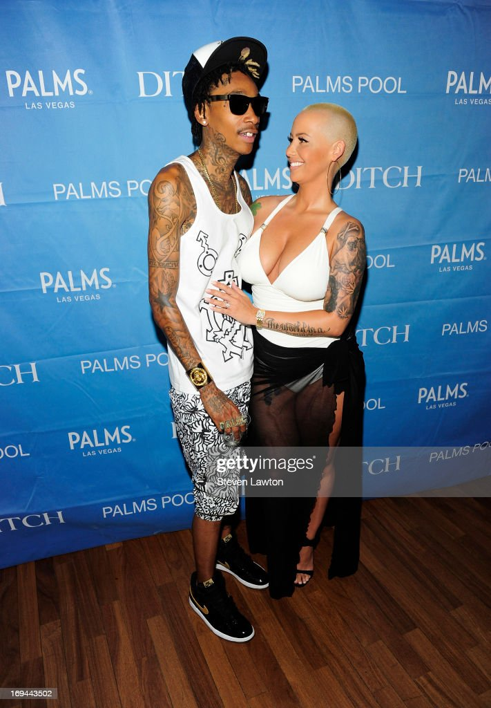Rapper <a gi-track='captionPersonalityLinkClicked' href=/galleries/search?phrase=Wiz+Khalifa&family=editorial&specificpeople=7183449 ng-click='$event.stopPropagation()'>Wiz Khalifa</a> (L) and model <a gi-track='captionPersonalityLinkClicked' href=/galleries/search?phrase=Amber+Rose+-+Mannequin&family=editorial&specificpeople=2025513 ng-click='$event.stopPropagation()'>Amber Rose</a> arrive at Ditch Fridays during Memorial Day weekend at the Palms Casino Resort on May 24, 2013 in Las Vegas, Nevada.