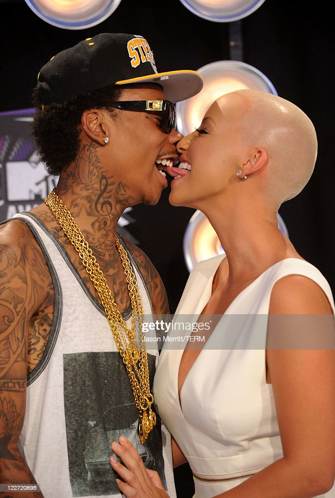 Rapper Wiz Khalifa (L) and model Amber Rose arrive at the 2011 MTV Video Music Awards at Nokia Theatre L.A. LIVE on August 28, 2011 in Los Angeles, California.