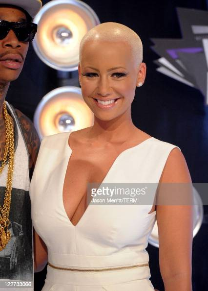 Rapper Wiz Khalifa and model Amber Rose arrive at the 2011 MTV Video Music Awards at Nokia Theatre LA LIVE on August 28 2011 in Los Angeles California
