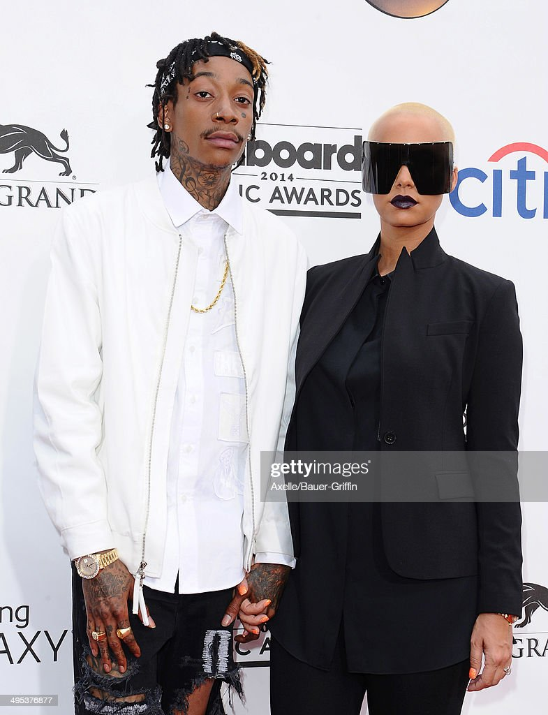 Rapper Wiz Khalifa and model Amber Rose arrive at the 2014 Billboard Music Awards at the MGM Grand Garden Arena on May 18, 2014 in Las Vegas, Nevada.