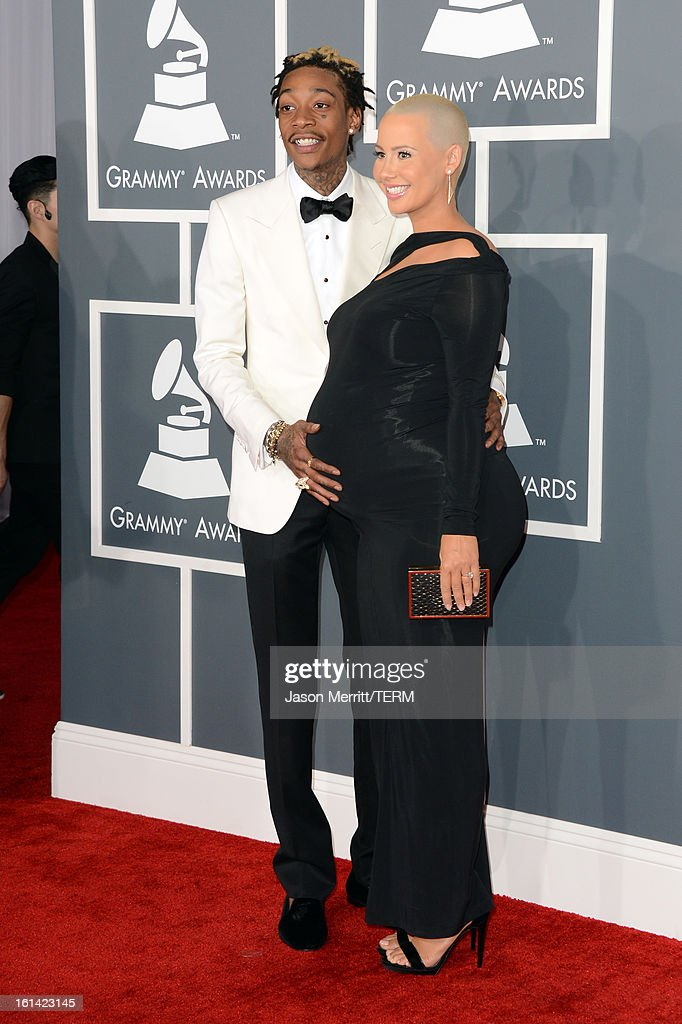 Rapper Wiz Khalifa (L) and model Amber Rose arrive at the 55th Annual GRAMMY Awards at Staples Center on February 10, 2013 in Los Angeles, California.