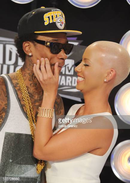 Rapper Wiz Khalifa and model Amber Rose arrive at the The 28th Annual MTV Video Music Awards at Nokia Theatre LA LIVE on August 28 2011 in Los...
