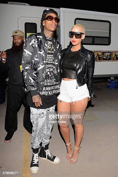 Rapper Wiz Khalifa and model Amber Rose attend the 2014 mtvU Woodie Awards and Festival on March 13 2014 in Austin Texas