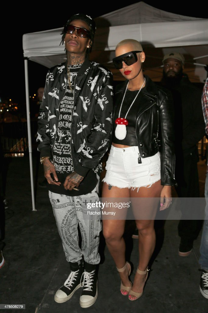 Rapper <a gi-track='captionPersonalityLinkClicked' href=/galleries/search?phrase=Wiz+Khalifa&family=editorial&specificpeople=7183449 ng-click='$event.stopPropagation()'>Wiz Khalifa</a> and model <a gi-track='captionPersonalityLinkClicked' href=/galleries/search?phrase=Amber+Rose+-+Model&family=editorial&specificpeople=2025513 ng-click='$event.stopPropagation()'>Amber Rose</a> attend the 2014 mtvU Woodie Awards and Festival on March 13, 2014 in Austin, Texas.
