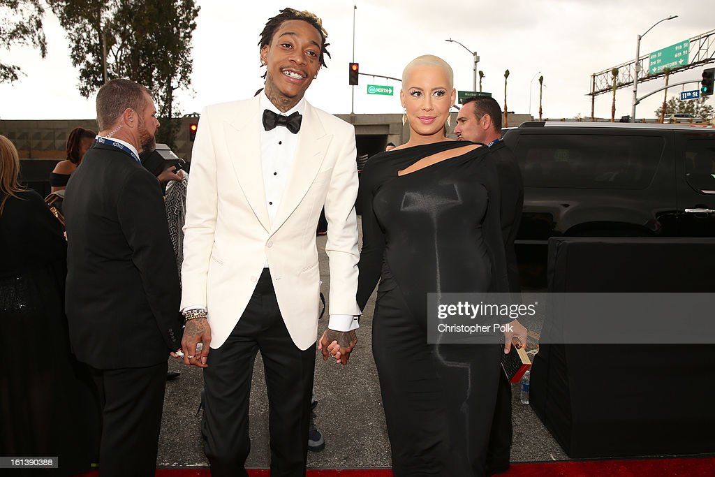 Rapper Wiz Khalifa (L) and model Amber Rose attend the 55th Annual GRAMMY Awards at STAPLES Center on February 10, 2013 in Los Angeles, California.