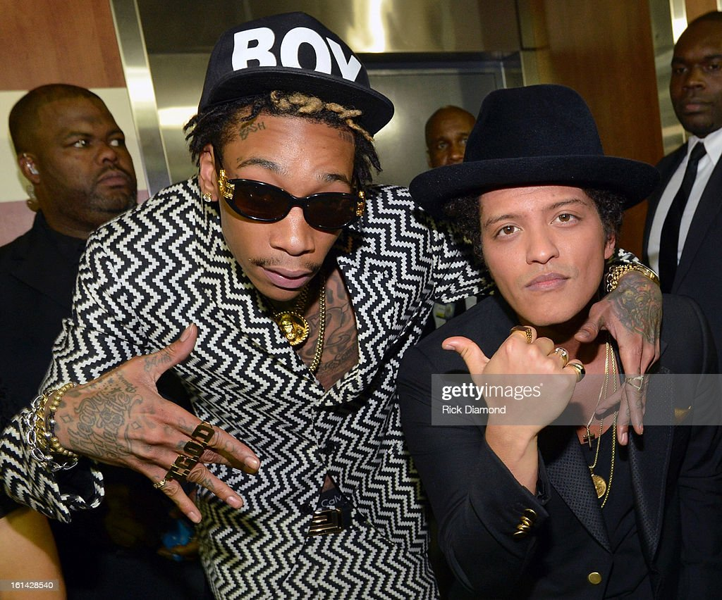 Rapper <a gi-track='captionPersonalityLinkClicked' href=/galleries/search?phrase=Wiz+Khalifa&family=editorial&specificpeople=7183449 ng-click='$event.stopPropagation()'>Wiz Khalifa</a> (L) and singer <a gi-track='captionPersonalityLinkClicked' href=/galleries/search?phrase=Bruno+Mars&family=editorial&specificpeople=6779692 ng-click='$event.stopPropagation()'>Bruno Mars</a> attend the 55th Annual GRAMMY Awards at STAPLES Center on February 10, 2013 in Los Angeles, California.