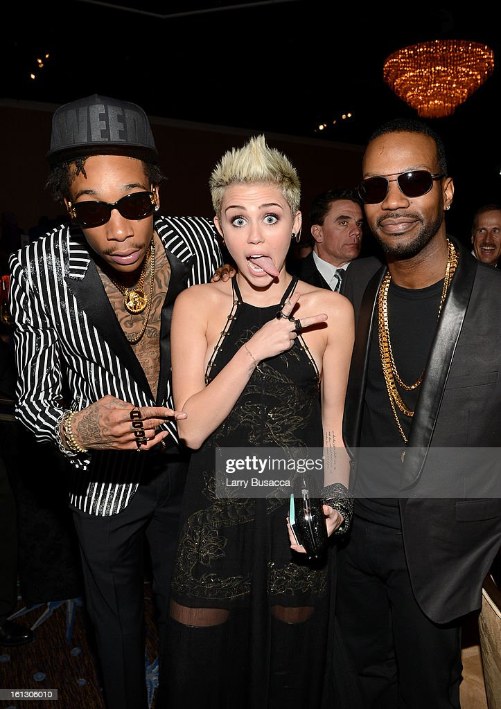 Rapper <a gi-track='captionPersonalityLinkClicked' href=/galleries/search?phrase=Wiz+Khalifa&family=editorial&specificpeople=7183449 ng-click='$event.stopPropagation()'>Wiz Khalifa</a>, <a gi-track='captionPersonalityLinkClicked' href=/galleries/search?phrase=Miley+Cyrus&family=editorial&specificpeople=3973523 ng-click='$event.stopPropagation()'>Miley Cyrus</a> and guest attend the 55th Annual GRAMMY Awards Pre-GRAMMY Gala and Salute to Industry Icons honoring L.A. Reid held at The Beverly Hilton on February 9, 2013 in Los Angeles, California.