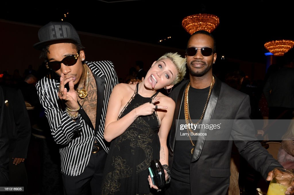 Rapper Wiz Khalifa, Miley Cyrus and guest attend the 55th Annual GRAMMY Awards Pre-GRAMMY Gala and Salute to Industry Icons honoring L.A. Reid held at The Beverly Hilton on February 9, 2013 in Los Angeles, California.
