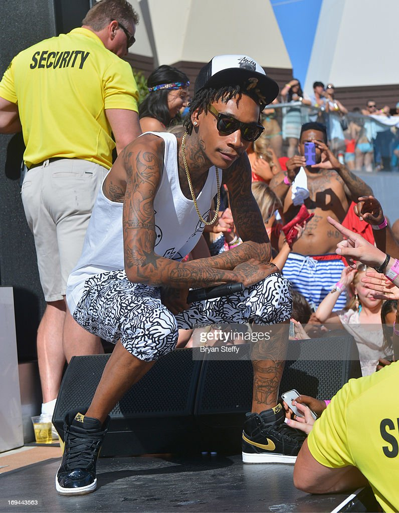 Rapper Wiz Khalifa performs during Ditch Fridays at the Palms Pool & Bungalows at the Palms Casino Resort on May 24, 2013 in Las Vegas, Nevada.