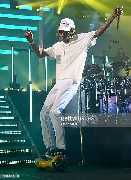 Rapper Wiz Khalifa rides a PhunkeeDuck personal transportation device onstage as he performs at the Mandalay Bay Events Center during a stop of the...