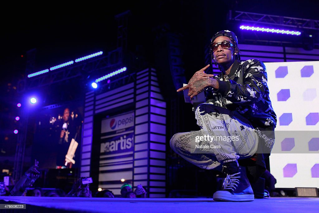 Rapper <a gi-track='captionPersonalityLinkClicked' href=/galleries/search?phrase=Wiz+Khalifa&family=editorial&specificpeople=7183449 ng-click='$event.stopPropagation()'>Wiz Khalifa</a> speaks onstage at the 2014 mtvU Woodie Awards and Festival on March 13, 2014 in Austin, Texas.