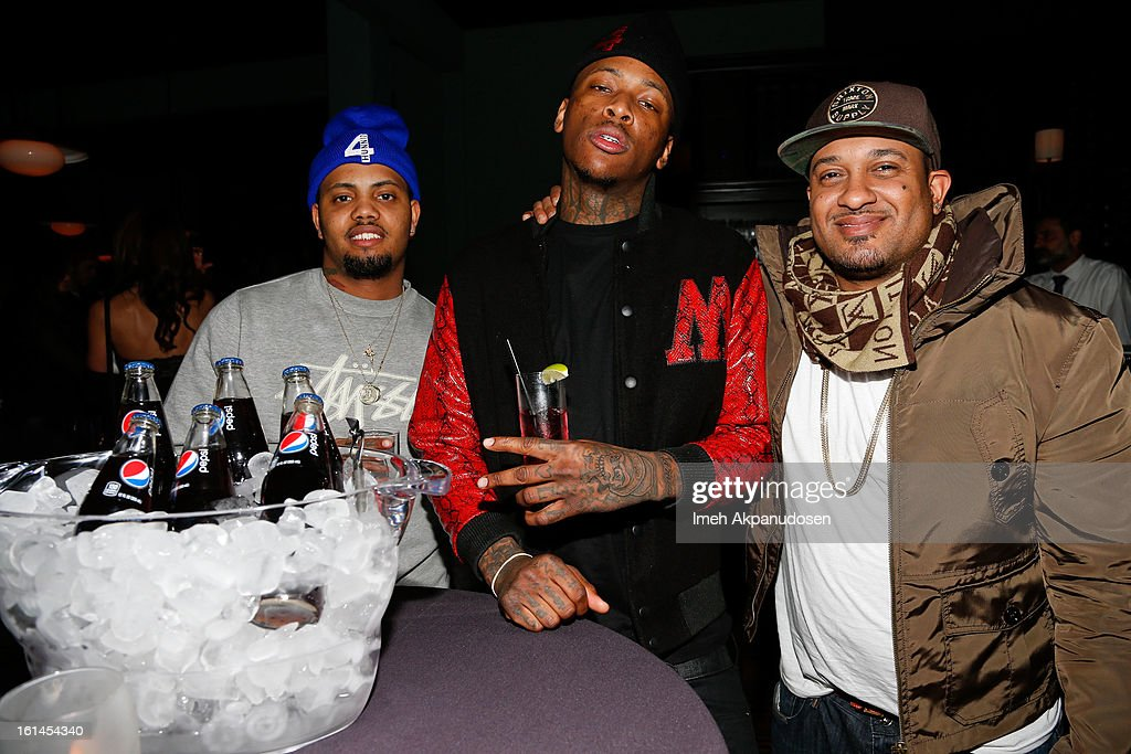 Rapper YG (C) attends the Island Def Jam Grammy Party sponsored by Samsung and Pepsi at Osteria Mozza on February 10, 2013 in Los Angeles, California.