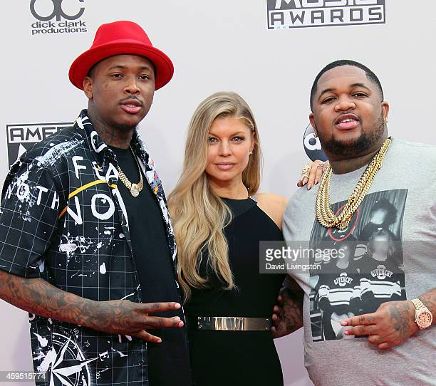 Rapper YG singer Fergie and DJ Mustard attend the 42nd Annual American Music Awards at the Nokia Theatre LA Live on November 23 2014 in Los Angeles...