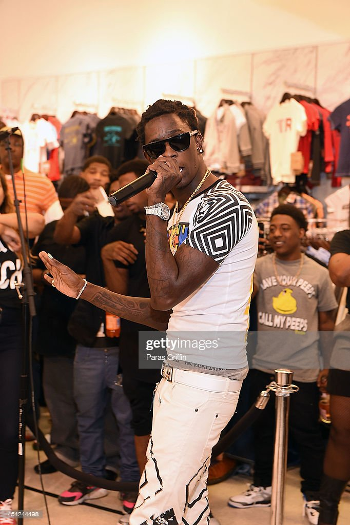 Rapper Young Thug performs at the Rich Homie Quan By 8732 Collection Launch at Pure Atlanta at Lenox Square on August 26 2014 in Atlanta Georgia