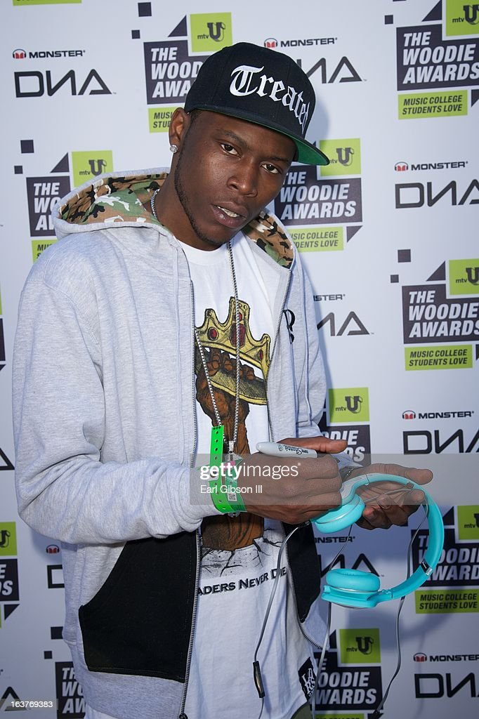 Rapper YP poses for a photo at the Monsterheadphones lounge at the mtvu Woodie Awards on March 14, 2013 in Austin, Texas.