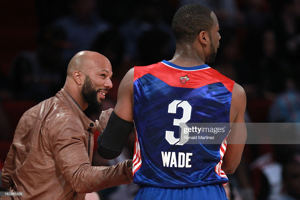 Rapper/actor Common talks with Dwyane Wade #3 of the Miami Heat and the Eastern Conference during the 2013 NBA All-Star game at the Toyota Center on February 17, 2013 in Houston, Texas.