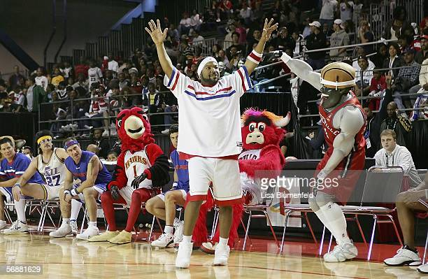 Rapper/actor Ice Cube waves to the crowd at the NBA AllStar Jam Session during NBA AllStar Weekend at the George R Brown Convention Center on...